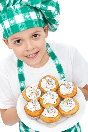 Little boy chef with muffins on a plate photo