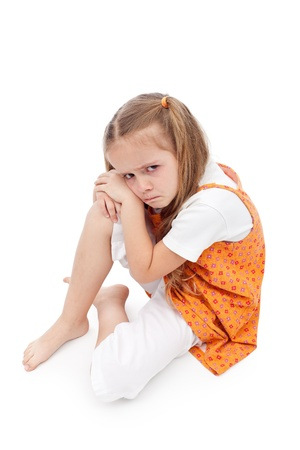 tantrum: Very upset little girl sitting on the floor about to cry Stock Photo