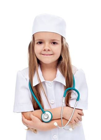 role play: Little girl playing nurse or doctor - vocational guidance concept, isolated Stock Photo