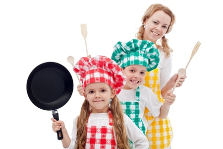 Happy chefs family standing in row holding cooking utensils - isolated photo
