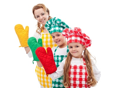 Happy chefs family standing in row waving with oven gloves - isolated photo