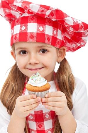 Little kitchen fairy holding muffin - closeup photo