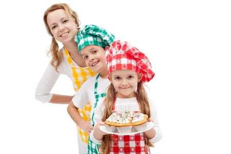 brigade: Chefs brigade preparing muffins - woman with kids, isolated Stock Photo