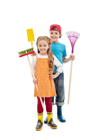 cleaning tools: Happy spring kids - with gardening tools and rubber boots, isolated Stock Photo