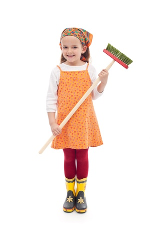 Little girl with broom and rubber boots - isolated photo