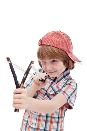disobedient child: Mischievous kid aiming with sling - isolated Stock Photo