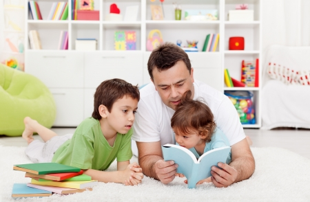 Father reading stories to his boy children at home Stock Photo - 13629410