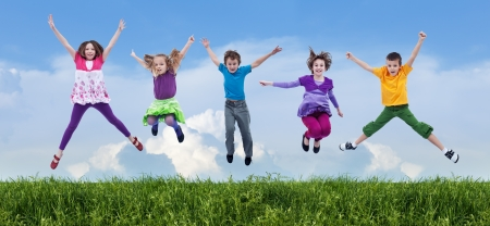 sport celebration: Happy children jumping on the spring field