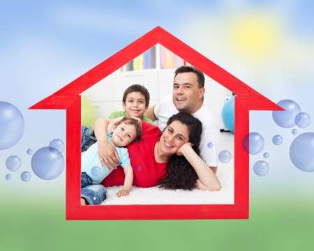 home safety: Dream home concept with family inside house sign on abstract sunny field