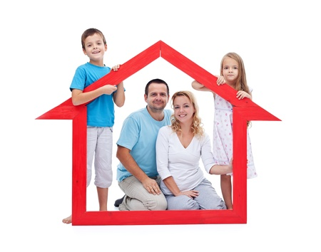 Young family with two kids holding house sign - new home concept, isolated photo