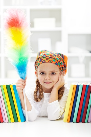kids room: Little girl dusting her room - cleaning day in the kids room Stock Photo