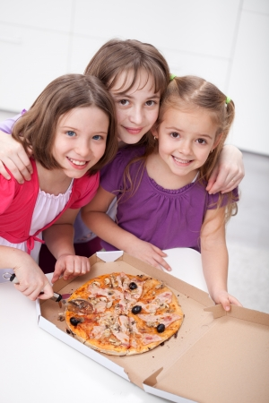 Three girlfriends sharing a pizza - childhood friendship photo