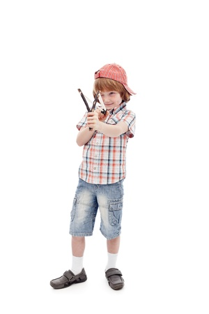 disobedient child: Young boy with sling aiming - full body, isolated