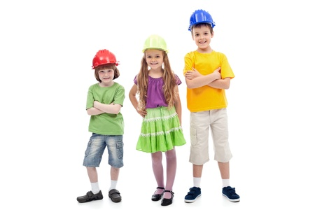 Kids with protective helmets posing - vocational guidance, isolated photo