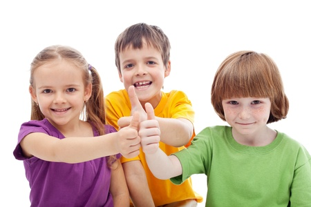 happy kids: Friends forever - childhood pals showing thumbs up signs, isolated Stock Photo