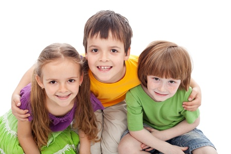 bracing: Childhood friends portrait - kids bracing each other, isolated Stock Photo