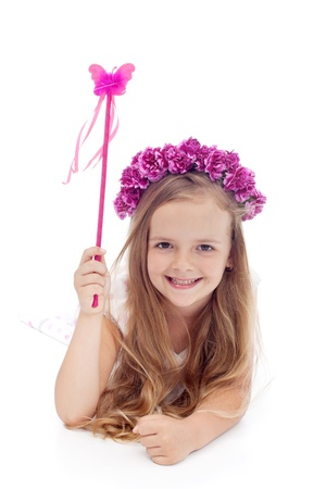 innocent girl: Little fairy with flower wreath and magic wand smiling