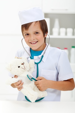 Little boy playing veterinary doctor with stethoscope photo