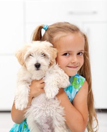 large dog: I got a little doggy - happy little girl hugging her pet
