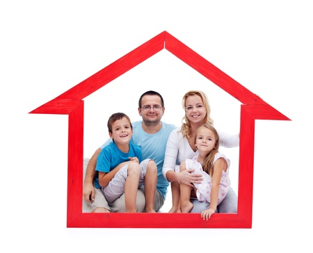 Happy family with kids in their home concept sitting in a house shaped frame - isolated Stock Photo - 15045561
