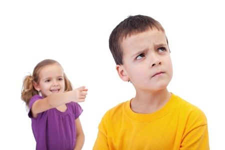hassle: Bullying concept - girl mocking an upset young boy, isolated
