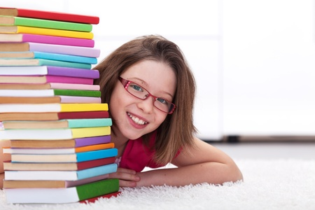 blue back: Young student with lots of books - happy and smiling