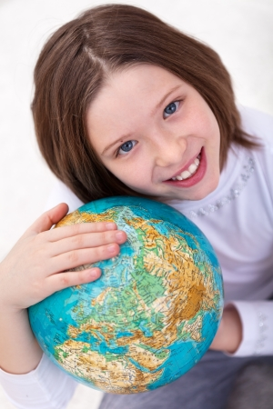 Love earth, it is our home - young girl with globe Stock Photo - 15045600