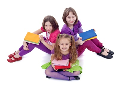 Group of young girls preparing to go back to school - on white background photo