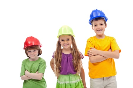 imitating: Professional guidance day - kids with hard hats, isolated Stock Photo