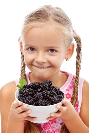 Yummy blackberries - happy healthy girl holding fresh fruits, isolated photo