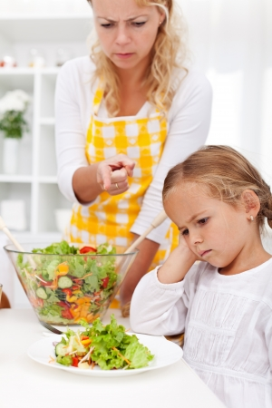 eat right: Eat your veggies right now - mother pointing her child in the right direction