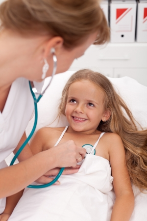 pediatric nurse: Healthcare professional checking up on little girl - happy recovery concept