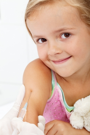 Smiling child receiving vaccine - healthcare concept, closeup photo