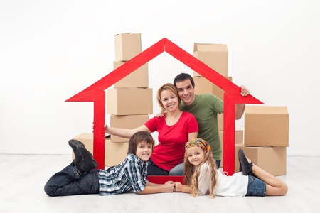 home safety: Happy family in a new home concept - sitting with cardboard boxes