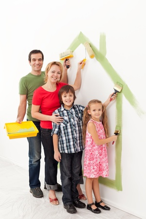 Family with kids painting together in their new home concept photo
