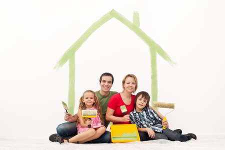 Family with two kids repainting their home - redecorating together photo