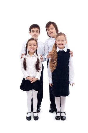 Group of happy and well groomed elementary school kids - isolated photo