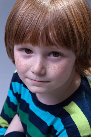Cute little boy with freckles portrait - top view Stock Photo - 17565835