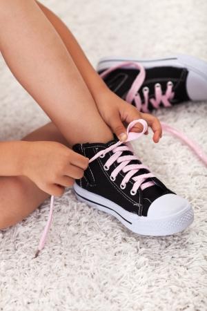 shoelace: Child hands tie shoelaces - closeup
