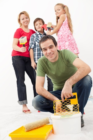 redecorating: Family redecorating together - painting their home