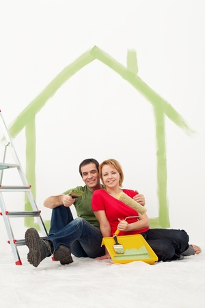 home renovation: Couple with painting utensils resting in their home - redecorating concept Stock Photo