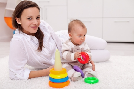 Baby girl and her mother playing at home Stock Photo - 17850674