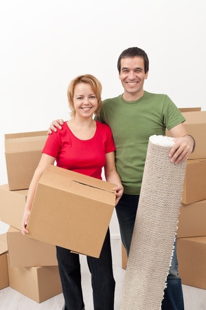 Happy couple moving into a new home together Stock Photo - 18162521