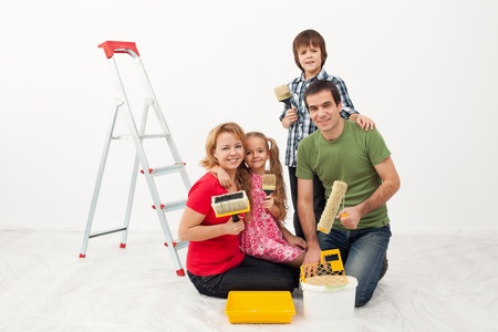 Happy people family preparing to paint their home Stock Photo - 18162515