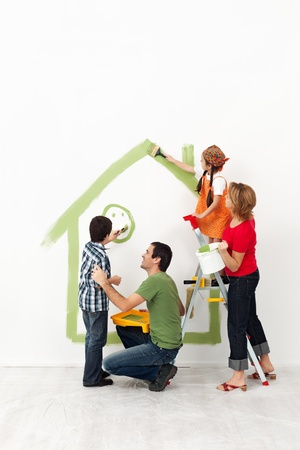 Happy family painting their home together with the kids photo