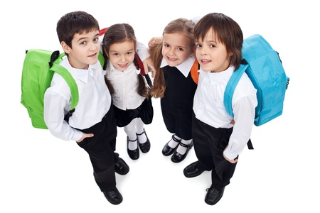 Happy school kids with back packs - holding each other, looking up - isolated