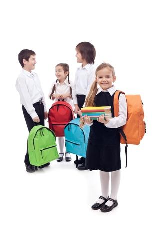 school children uniform: Happy school kids group  - isolated