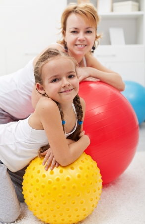 gym floor: Happy people relaxing during gym exercises - smiling