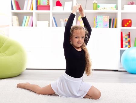Little girl playing ballerina at home - childhood fantesies photo