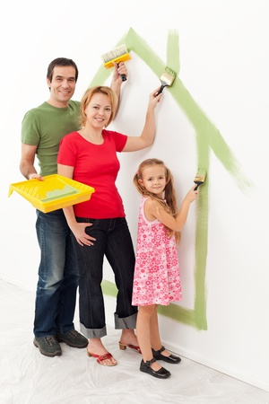 Family in their new house - making it a cozy home together concept Stock Photo - 18494346